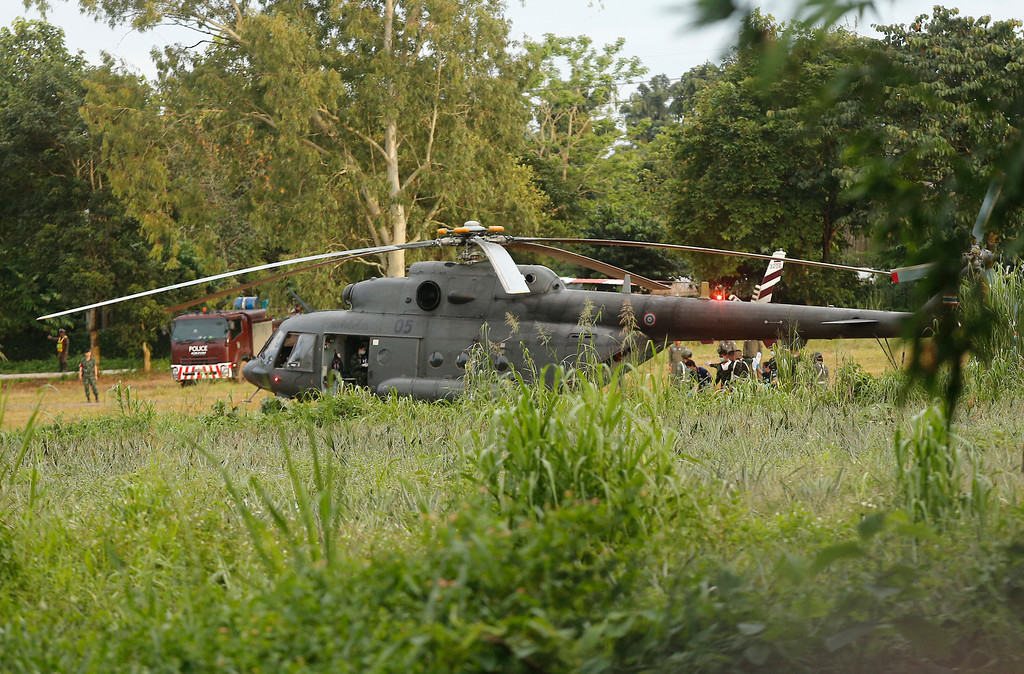 . A Thai military evacuation helicopter as the remaining trapped boys and their coach are extracted from a cave in Mae Sai, Chiang Rai province, northern Thailand on Tuesday, July 10, 2018. Thai Navy SEALs say all 12 boys and their coach have been rescued from the cave, ending an ordeal that lasted more than 2 weeks. (AP Photo)