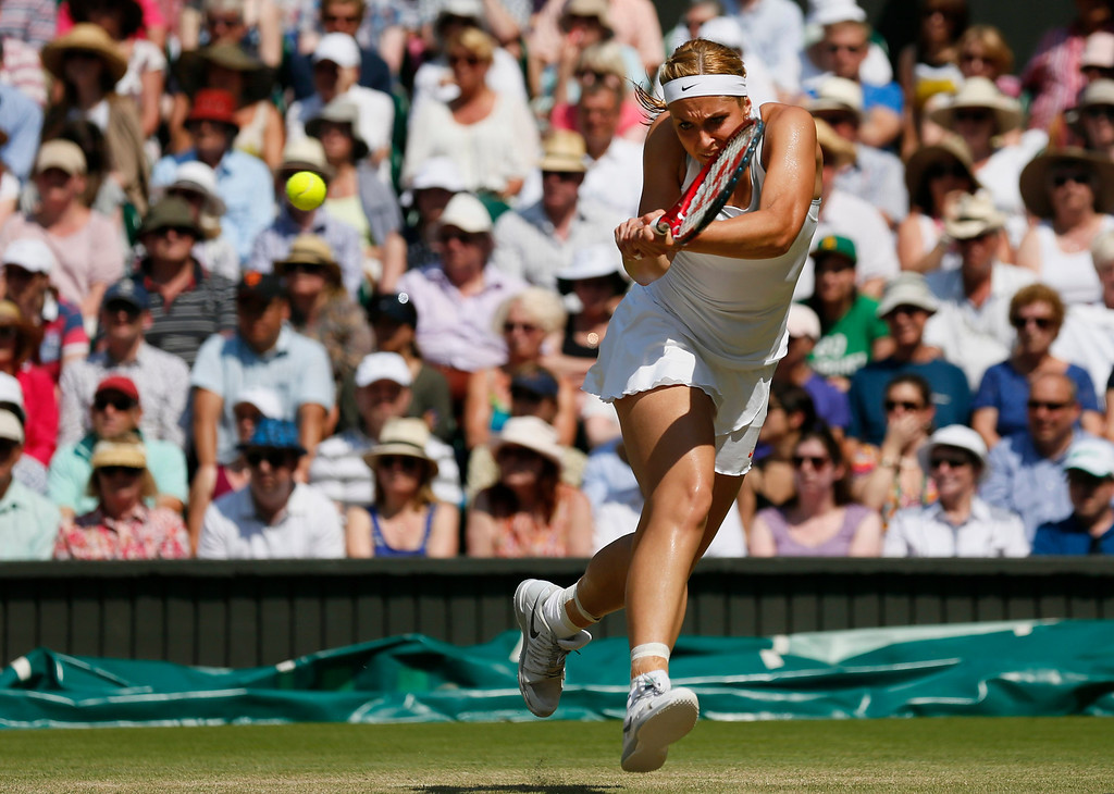 . Sabine Lisicki of Germany returns to Marion Bartoli of France during their Women\'s singles final match at the All England Lawn Tennis Championships in Wimbledon, London, Saturday, July 6, 2013.  (AP Photo/Stefan Wermuth, Pool)