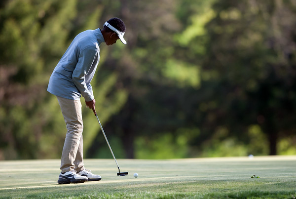 05/10/18 Wesley Bunnell   Staff New Britain golf defeated Bristol Eastern 212-219 at Stanley Golf Course on Thursday afternoon. New Britain's Dylan Washington putts on the 9th hole.