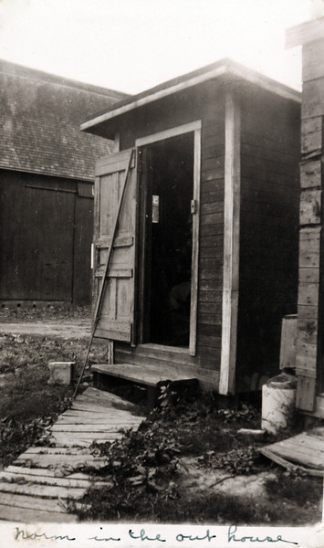 Uncle Norm in the outhouse.JPG