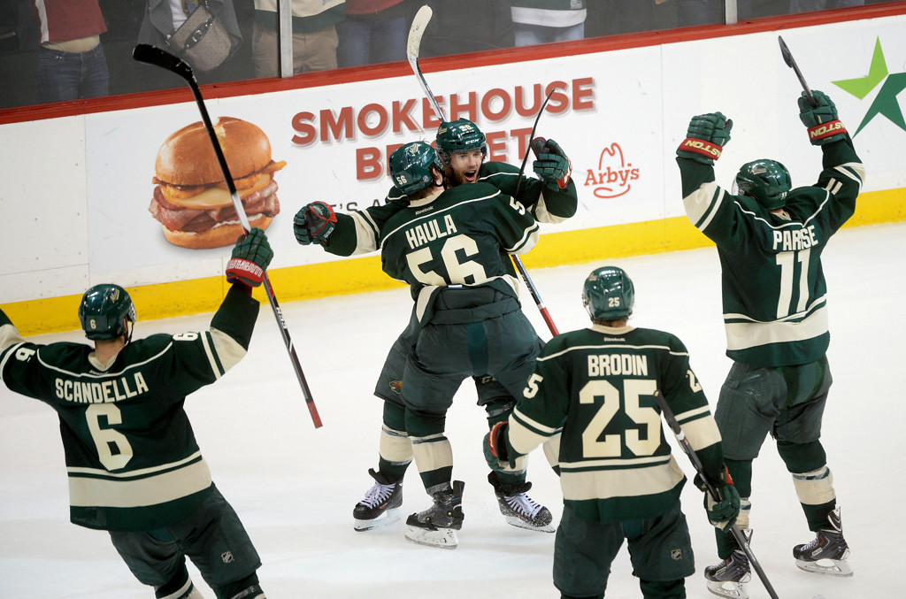 . Minnesota Wild players, left to right, Marco Scandella, Erik Haula, Jason Pominville, Jonas Brodin and Zach Parise celebrate Pominville\'s empty-net goal during the third period.  (Pioneer Press: Sherri LaRose-Chiglo)