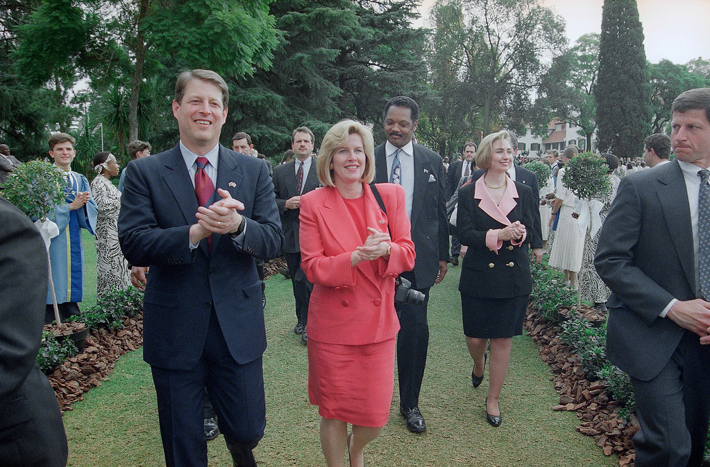 . U.S. Vice-President Al Gore, his wife Tipper, Rev. Jesse Jackson and First Lady Hillary Rodham Clinton clap their hands to the beat of the music as they arrive for lunch at the Presidency in Pretoria, Tuesday, May 10, 1994. They had attended the inauguration ceremony for South Africa?s new President Nelson Mandela earlier in the day. (AP Photo)