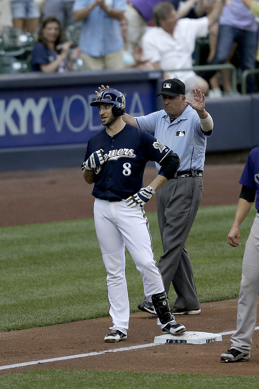 . MILWAUKEE, WI - JUNE 28: Ryan Braun #8 of the Milwaukee Brewers celebrates at third base after hitting a 2 RBI triple in the bottom of the fifth inning against the Colorado Rockies at Miller Park on June 28, 2014 in Milwaukee, Wisconsin. (Photo by Mike McGinnis/Getty Images)