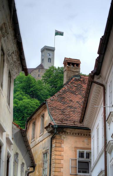 Clock tower of Ljubljana castle with town flag - Ljubljana, Slovenia