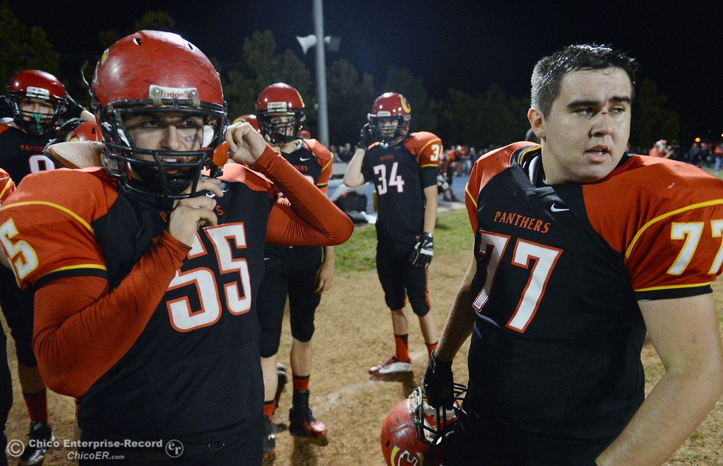 . Chico High\'s #55 Thomas Devlin (left) and #77 Brandon Zepeda (right) against Central Valley High in the first quarter of their football game at Asgard Yard Friday, September 27, 2013, in Chico, Calif.  (Jason Halley/Chico Enterprise-Record)