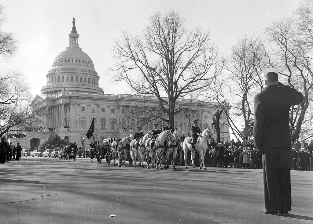 . A horse-drawn caisson  moves out of the Capitol plaza en route to St. Matthew\'s Cathedral for funeral services Nov. 25, 1963. Associated Press file