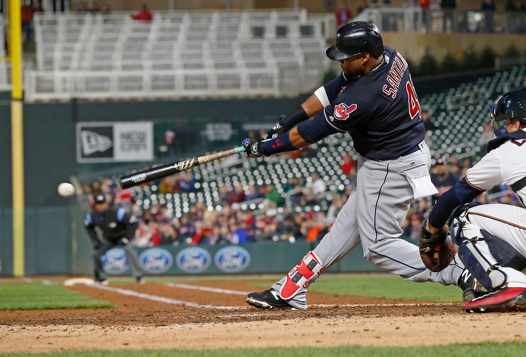 . Cleveland Indians\' Carlos Santana drives in a run with a single off Minnesota Twins pitcher Phil Hughes during the fourth inning of a baseball game Tuesday, April 18, 2017, in Minneapolis. (AP Photo/Jim Mone)
