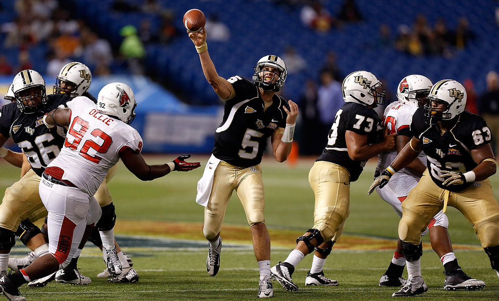 . Quarterback Blake Bortles #5 of the Central Florida Knights throws a pass against the Ball State Cardinals during the Beef \'O\' Brady\'s St Petersburg Bowl Game at Tropicana Field on December 21, 2012 in St Petersburg, Florida.  (Photo by J. Meric/Getty Images)