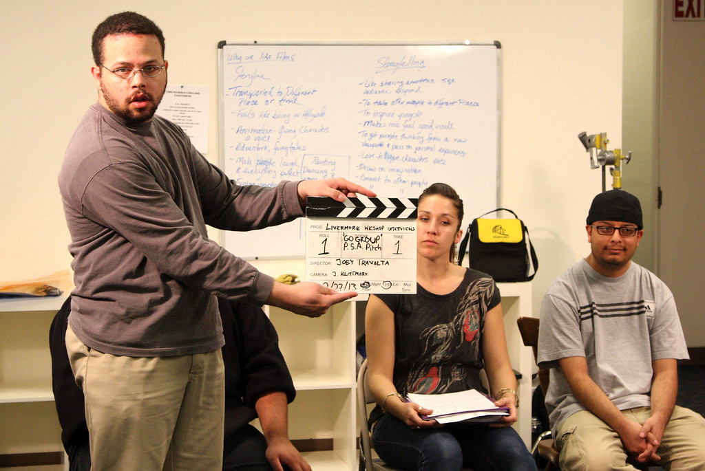 . Student Michael Tuttle marks the beginning of a taping in the Practical Film and Media Workshop class sponsored by Futures Explored and Inclusion Films at their new campus in Livermore, Calif. on Wednesday, Feb. 27, 2013. The vocational film program takes participants through the process of film makng from pre to post production. The film camp gives practical training to autistic adults.  (Jim Stevens/Staff)