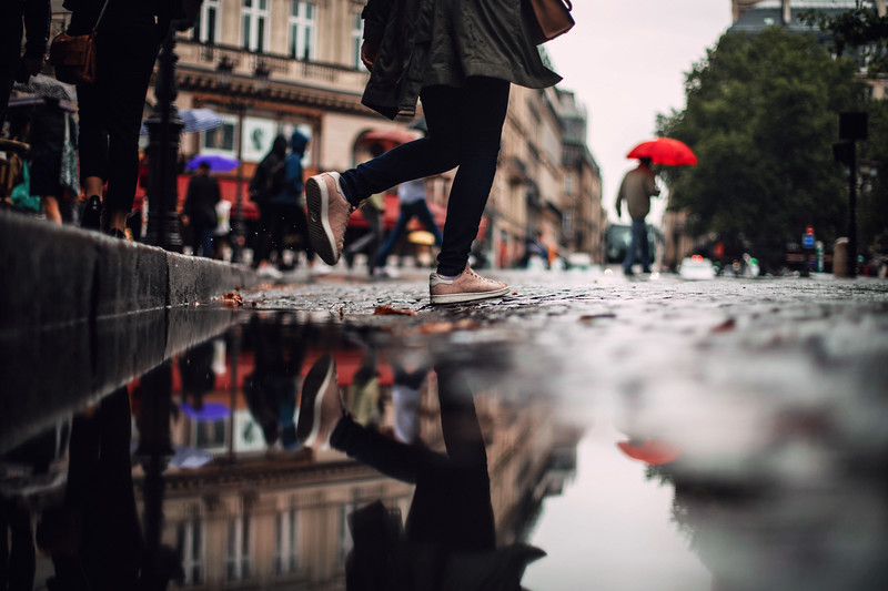 red umbrella and feet paris.jpg