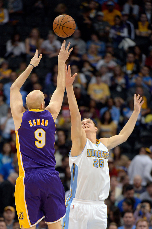 . DENVER, CO - NOVEMBER 13: Los Angeles Lakers center Chris Kaman (9) takes a shot over Denver Nuggets center Timofey Mozgov (25) during the first quarter November 13, 2013 at Pepsi Center. (Photo by John Leyba/The Denver Post)