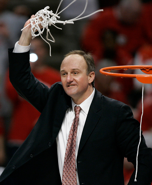 . Ohio State coach Thad Matta waves the net following his team\'s Big Ten Tournament championship victory over Wisconsin, 66-49, in Chicago, Sunday, March 11, 2007 (AP Photo/Brian Kersey)