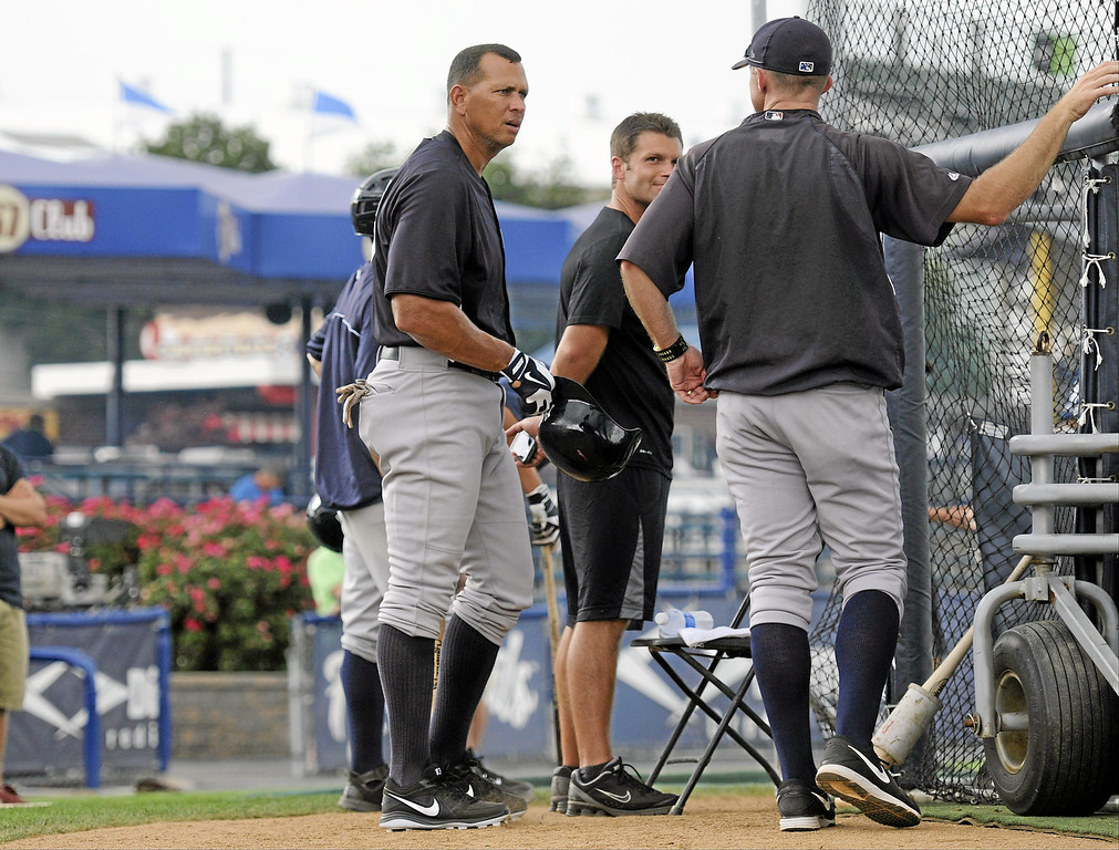 . New York Yankees\' Alex Rodriguez, left, during pregame warmups for a Class AA baseball game with the Trenton Thunder against the Reading Phillies, Monday, July 15, 2013, in Reading, Pa. Rodriguez is doing a rehab assignment with the Thunder recuperating from hip surgery. (AP Photo/Reading Eagle, Jeremy Drey)