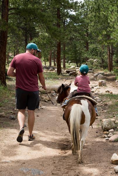 Caleb riding buttons 3.jpg