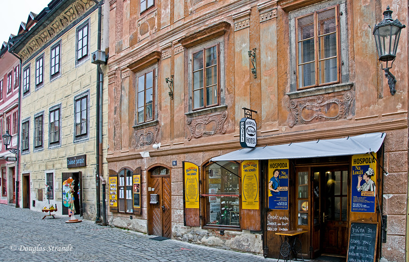 Businesses along a cobblestone street in Cesky Krumlov