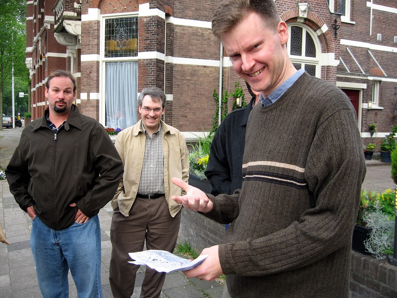 William questions key navigational proposals while Matt and Paul look on, in front of the Hotel Petit in The Hague