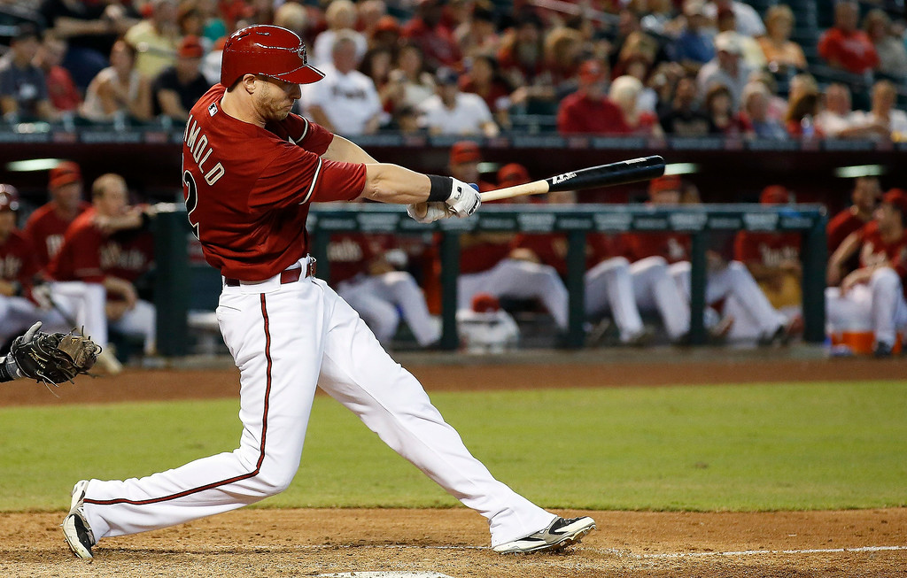 . Arizona Diamondbacks pinch hitter Nolan Reimold connects for a two-run home run against the Colorado Rockies during the seventh inning of a baseball game Sunday, Aug. 31, 2014, in Phoenix. (AP Photo/Ross D. Franklin)