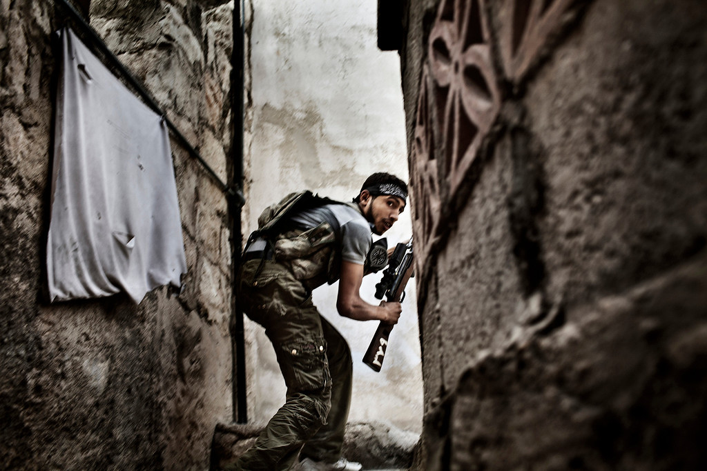 . World Press Photo 2nd prize Spot News Stories by Fabio Bucciarelli, Italy, for Agence France-Presse, a Free Syrian Army (FSA) fighter takes position during the clashes against Syrian government forces in Sulemain Halabi district in Aleppo, Syria, Oct. 10, 2012. (AP Photo/Fabio Bucciarelli, Agence France-Presse)