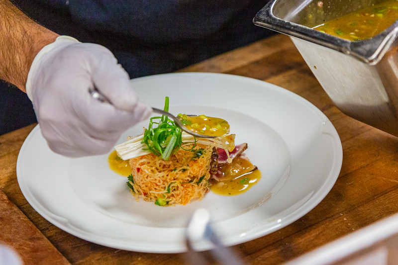 Executive chef Rolando Anoceto prepares Tuna Mee Grob an appetizer with vermicelli noodles, scallions, citrus vinaigrette at City Cellar in West Palm Beach, FL on Friday, December 6, 2019. City Cellar is turning 20 years old.[JOSEPH FORZANO/palmbeachpost.com]