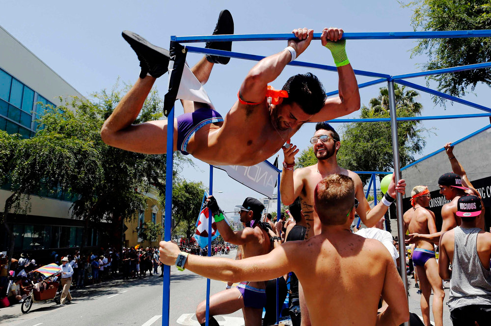 . Dancers perform stunts on the Andrew Christian underwear float during the 43rd annual LA LGBT Pride Parade in West Hollywood, California June 9, 2013. The parade celebrates the lesbian, gay, bisexual and transgender communities in Los Angeles. REUTERS/Patrick T. Fallon