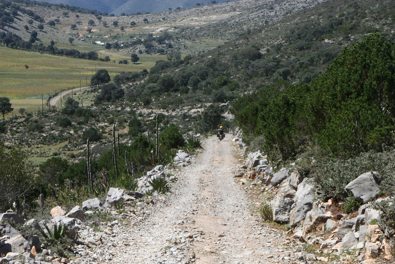 Once over the top, the road drops down into a large valley.