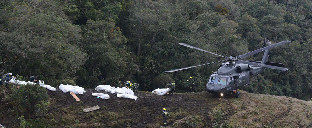 . Rescue workers carry onto a helicopter the bodies of victims of an airplane that crashed in La Union, a mountainous area near Medellin, Colombia, Tuesday , Nov. 29, 2016. The plane was carrying the Brazilian first division soccer club Chapecoense team that was on it\'s way for a Copa Sudamericana final match against Colombia\'s Atletico Nacional. (AP Photo/Luis Benavides)