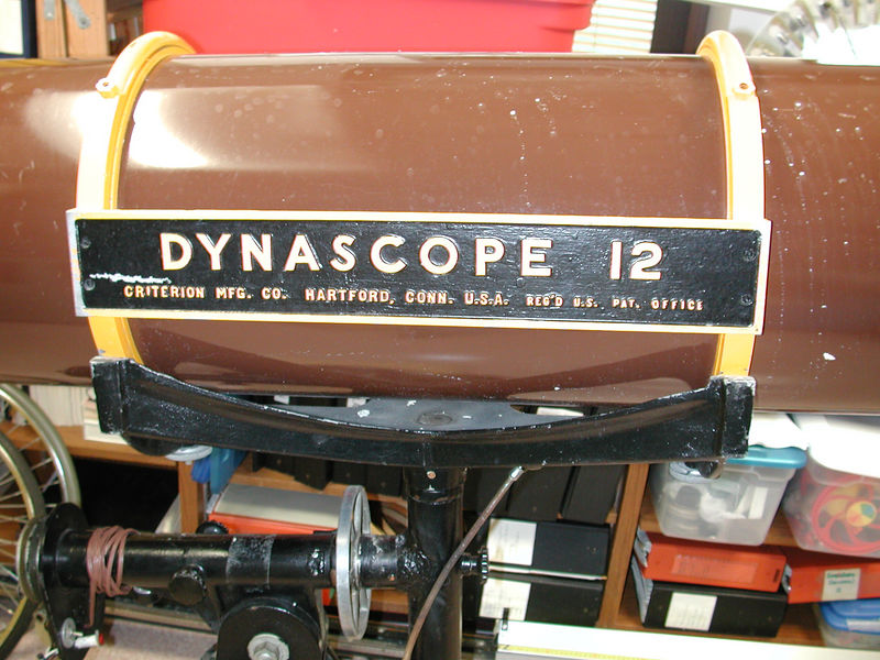 """Original plate from Criterion made of cast aluminum. In checking Sky and Telescope sources it appears that the Dynascope 12 was available from the 1950's until 1963. In January 1963 The Dynascope was listed available in """"Your choice of 6, 8, 10, 12 and 16 inch models within the magazine."""" The Feb & March 1963 issues featured advertising of the 6 inch RV-6 Dynascope inside the back cover. However both of the same additions; Feb & , March 1963 shows that a 12.5 inch mirror from Criterion at F-7 is available for $ 299 under more Criterion advertising within those same issues. The April 1963 edition again featured the Dynascope in 6, 8, 10 12, and 16 inch models. New to the May 1963 Sky & telescope are Custom Dynascopes in your choice of 6, 8,10,  12.5 or 16 inch models. Therefore -  perhaps it maybe assumed this was about the time of the change over to the  12.5 inch Dynascope. Incidently the new 12.5 inch Deluxe Dynascope was priced $ 1265.00 from the factory at 331 Church St, Hartford, Conn. per said advertisement."""