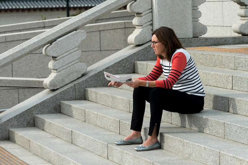 Woman sitting on steps, Seoul, south Korea