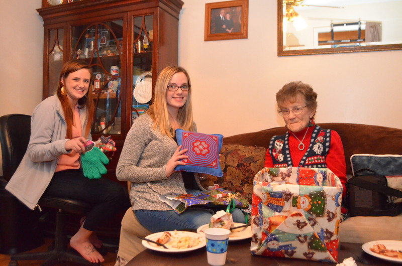 Girls with Grandma exchanging gifts.