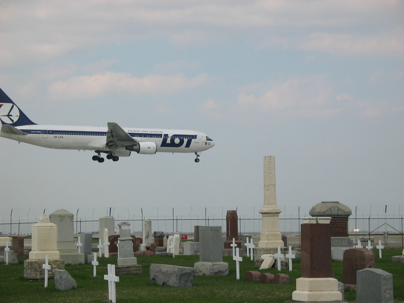 LOT airplane over cemetery