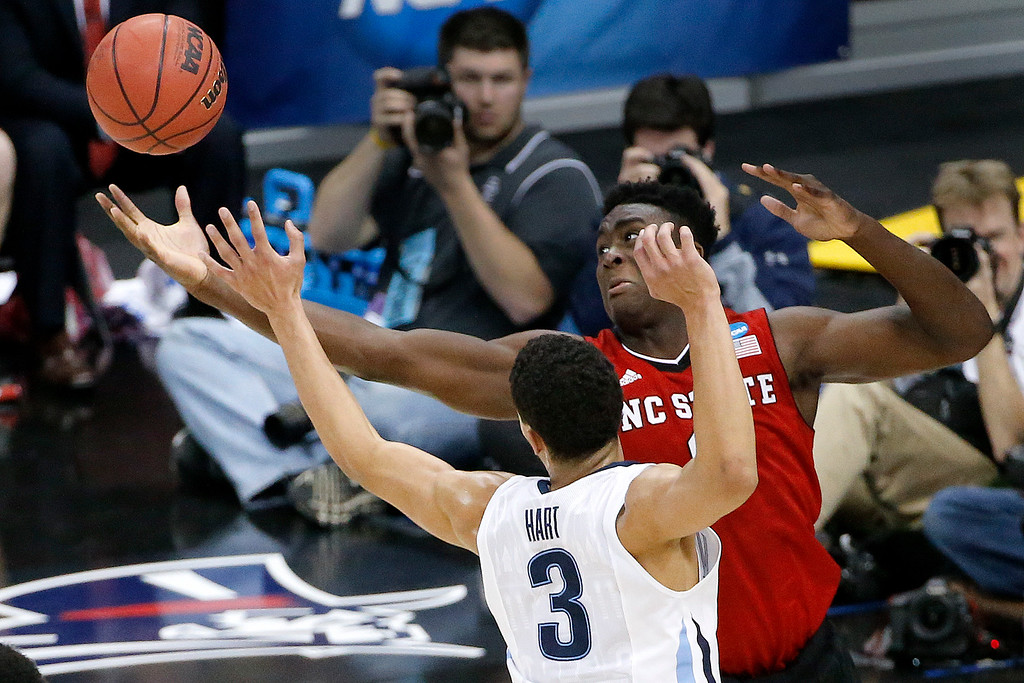 . North Carolina State\'s Abdul-Malik Abu, right, and Villanova\'s Josh Hart (3) reach for a rebound during the second half of an NCAA college basketball tournament Round of 32 game Saturday, March 21, 2015, in Pittsburgh. (AP Photo/Gene J. Puskar)