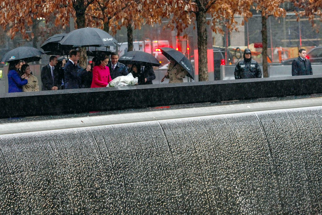 . Britain\'s Prince William, Duke of Cambridge, and Princess Kate, Duchess of Cambridge visit the National September 11 Memorial & Museum in a pouring rain on December 9, 2014 in New York. AFP PHOTO/ EDUARDO MUNOZ  ALVAREZ/AFP/Getty Images