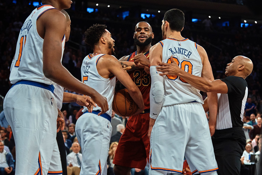 . Cleveland Cavaliers\' LeBron James, center, discusses with New York Knicks\' Enes Kanter, center right, and Courtney Lee, center left, during the first half of a NBA basketball game at Madison Square Garden in New York, Monday, Nov. 13, 2017. (AP Photo/Andres Kudacki)