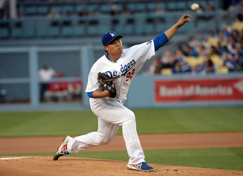 . Los Angeles Dodgers starting pitcher Hyun-Jin Ryu throws to the plate against the Philadelphia Phillies in the first inning of a baseball game on Tuesday, April 22, 2013 in Los Angeles.   (Keith Birmingham/Pasadena Star-News)