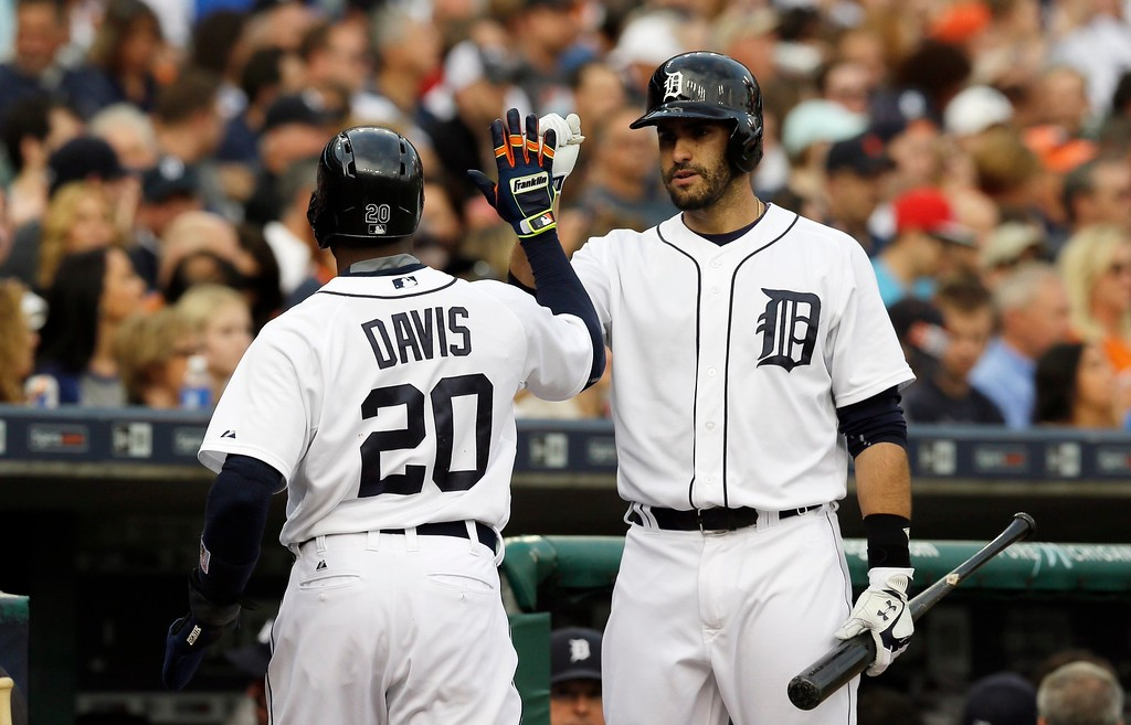 . Detroit Tigers\' Rajai Davis is congratulated by J.D. Martinez after scoring during the first inning of an interleague baseball game against the Chicago Cubs, Tuesday, June 9, 2015, in Detroit. (AP Photo/Carlos Osorio)