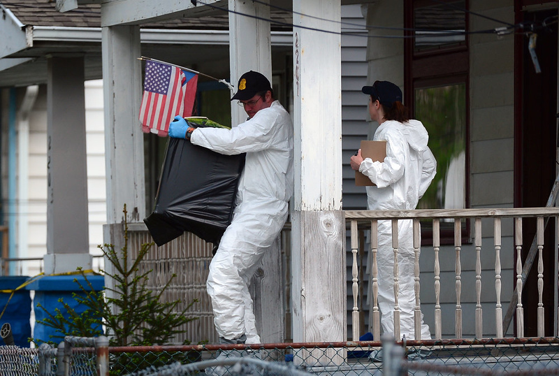 . FBI forensic personnel remove evidence from the house where three women were held captive for a decade on May 7, 2013 in Cleveland, Ohio.     EMMANUEL DUNAND/AFP/Getty Images