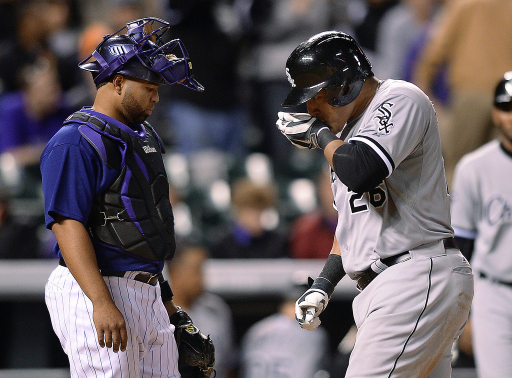 . Chicago slugger Avisail Garcia kissed his wrist as he crossed the plate in front of Colorado catcher Wilin Rosario following an eighth inning home run off Rockies reliever Wilton Lopez.  .  (Photo by Karl Gehring/The Denver Post)