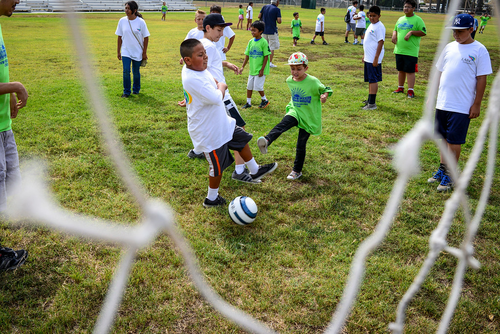 . Kids play on one the only soccer fields with grass at the renovation kick-off for the John Ferraro Soccer Fields at Griffith Park.  The city plans to work with the LA84 Foundation to help raise the 10 million necessary to renovate the fields and convert them to artificial turf.   ( Photo by David Crane/Los Angeles Daily News )