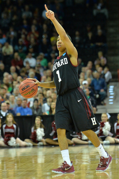 March 20, 2014: Harvard Crimson guard Siyani Chambers (1) calls out a play during a second round game of the NCAA Division I Men's Basketball Championship between the 5-seed Cincinnati Bearcats and the 12-seed Harvard Crimson at Spokane Arena in Spokane, Wash. Harvard defeated Cincinnati 61-57.