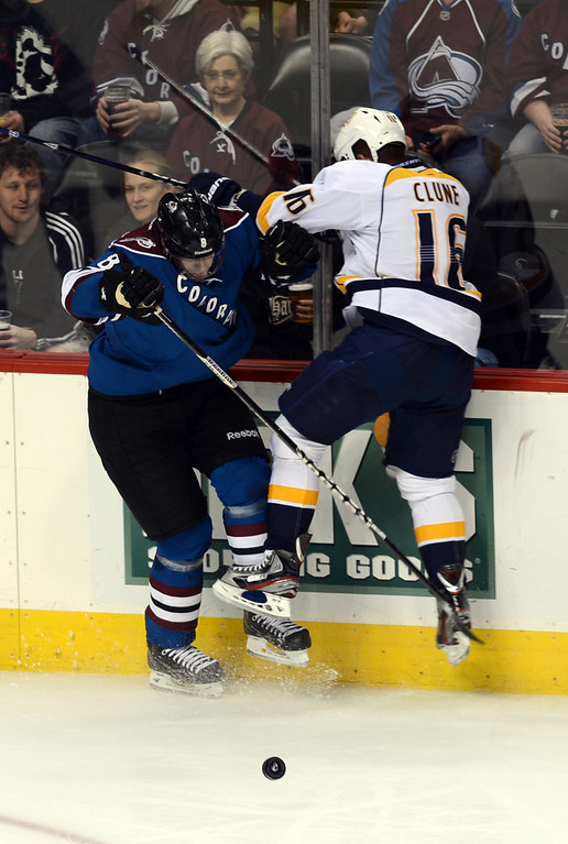. Jan Hejda of Colorado Avalanche (#8), left, checks Rich Clune of Nashville Predators (#16) in the 2nd period of the game at Pepsi Center. Denver, Colorado. March 30, 2013. (Photo By Hyoung Chang/The Denver Post)