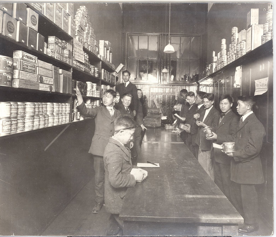""". Students work in a \""""store\"""" within Emily Griffith Opportunity School. Denver Post Library photo archive"""