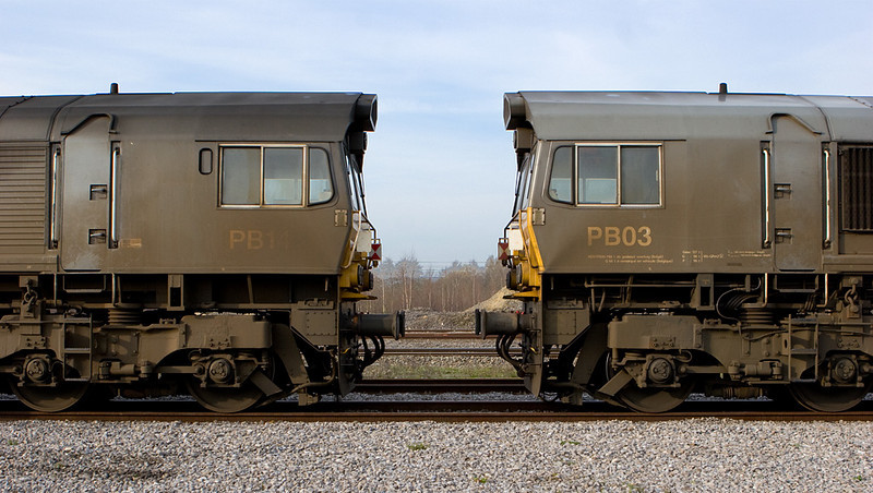 Dirty road warriors DLC PB14 and PB03 stand face to face in Montzen, waiting for their next assignments.