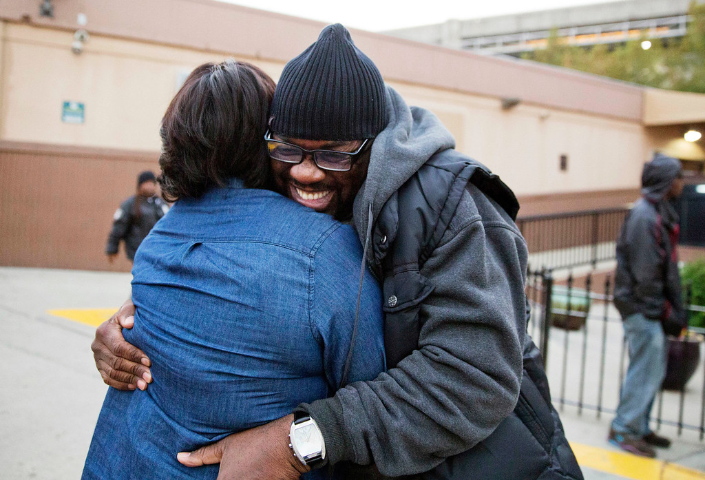 . Darryl Hamlett, right, embraces his fiancee Beverly Conners as he arrives off a bus from New York to spend the Thanksgiving holiday in Atlanta, Wednesday, Nov. 23, 2016. Almost 49 million people are expected to travel 50 miles or more for the Thanksgiving holiday, the most since 2007, according to AAA. (AP Photo/David Goldman)