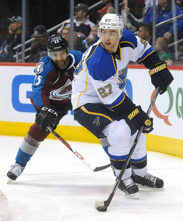 . St. Louis defenseman Alex Pietrangelo (27) skated behind his own net in front of Avalanche  center Maxime Talbot (25) in the third period.  Photo By Karl Gehring/The Denver Post