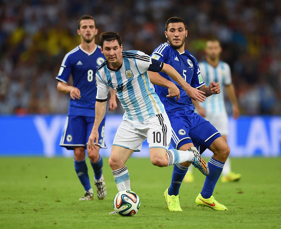 . Lionel Messi of Argentina controls the ball against Sead Kolasinac of Bosnia and Herzegovina during the 2014 FIFA World Cup Brazil Group F match between Argentina and Bosnia-Herzegovina at Maracana on June 15, 2014 in Rio de Janeiro, Brazil.  (Photo by Matthias Hangst/Getty Images)