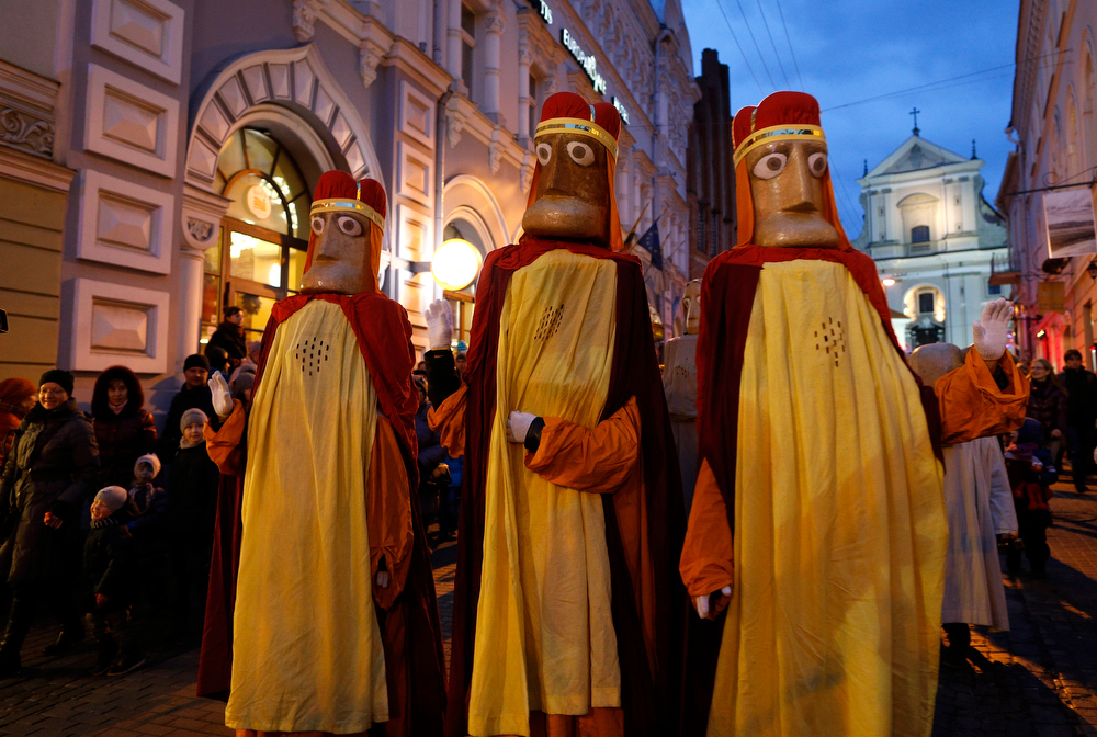 . Lithuanians dressed as the Three Kings, parade through the streets, during the Epiphany Day celebrations in downtown Vilnius, Lithuania, Monday, Jan. 6, 2014. Epiphany, the 12th night of Christmas, marks the day the three wise men visited Christ. (AP Photo/Mindaugas Kulbis)
