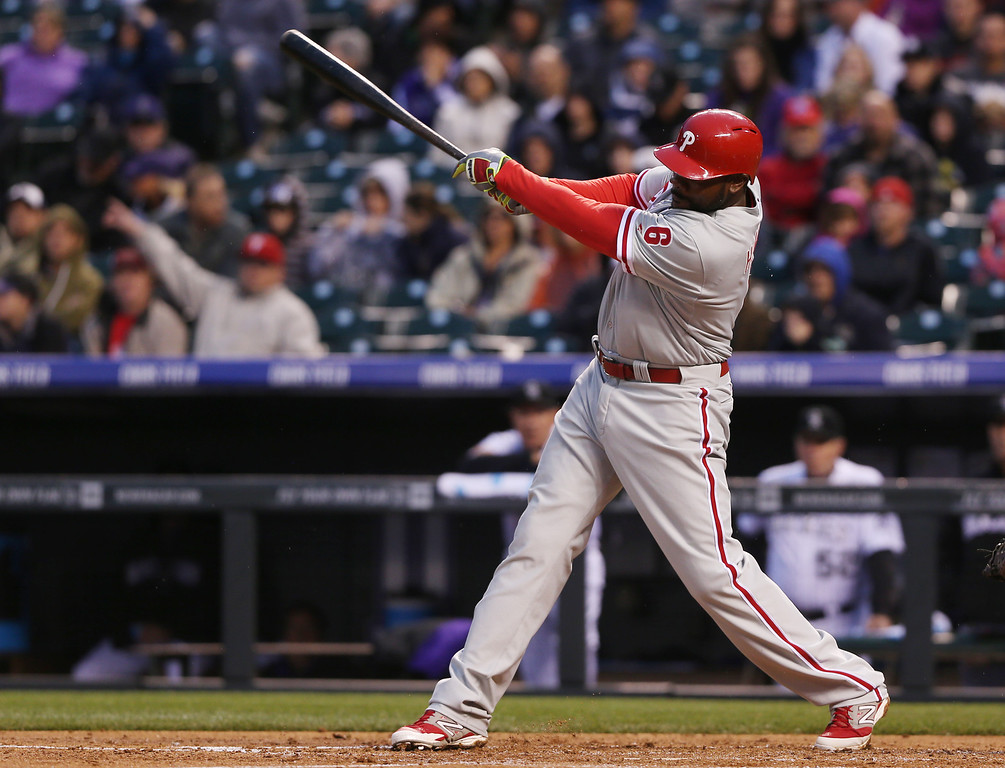 . Philadelphia Phillies\' Ryan Howard singles against the Colorado Rockies in the fourth inning of a baseball game in Denver on Saturday, April 19, 2014. (AP Photo/David Zalubowski)