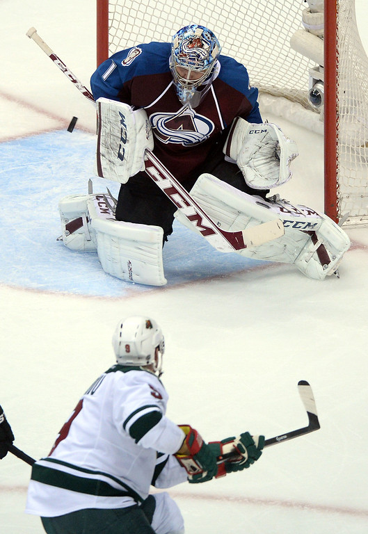 . DENVER, CO - APRIL 26: Semyon Varlamov (1) of the Colorado Avalanche blocks a shot by Mikko Koivu (9) of the Minnesota Wild during the third period. The Colorado Avalanche hosted the Minnesota Wild during game five of the first round of the NHL Stanley Cup Playoffs at the Pepsi Center on Saturday, April 26, 2014. (Photo by Karl Gehring/The Denver Post)