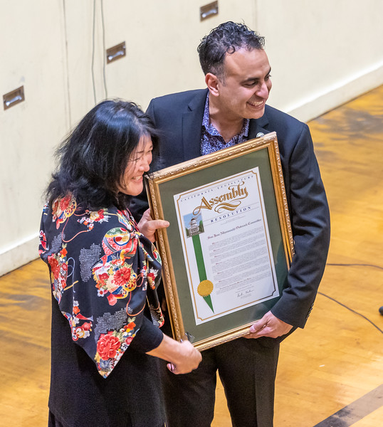 Assemblymember Ash Kalra presents the Nihonmachi Organizing Committee with a resolution from the CA Legislative Assembly.