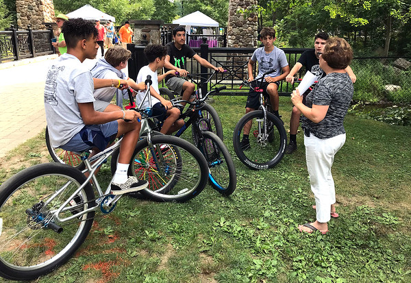 8/17/2019 Mike Orazzi | StaffnBristol Mayor Ellen Zoppo-Sassu talks with member of the &quote;biker gang&quote; talked about on social media about places they can ride their bikes without going on city streets during the 9th Annual Rockwell Park Summer Festival in Bristol on Saturday.